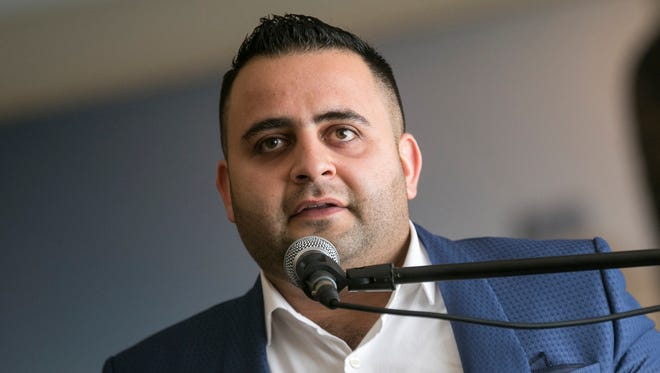 Yasir Ibrahim, a refugee from war-torn Iraq and now owner of both Caper Burger and Escalope restaurants in Sterling Heights, addresses the press following results of a report on the economic impact of refugees in metro Detroit at the Chaldean Cultural Center in West Bloomfield, Mich., Tuesday, October 17, 2017.