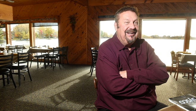 New owner Mike Dols talks about his plans Wednesday, Oct. 18, for the 400 Club on the shores of Pleasant Lake.