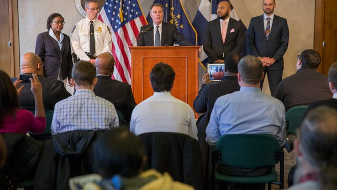 Indianapolis Mayor Joe Hogsett is flanked by city officials as he talks about the rising homicide rate, and new initiatives that he hopes will curb the trend, Indianapolis, Monday Mon. 11, 2017.
