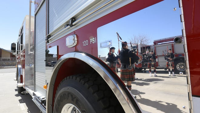 """The El Paso Fire Department Pipes and Drums play at the """"wet down"""" ceremony for Pumper 30 in Northeast El Paso in February."""