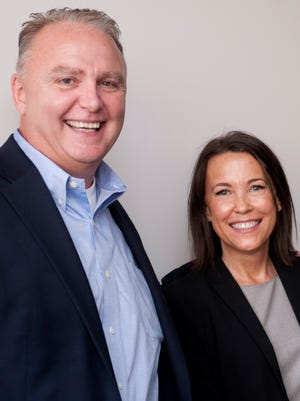 Brian Priester, president of Gannett Mid-Michigan and president of the Lansing State Journal, poses for a photo with Rebecca Poynter Steckler during a meeting on Wednesday, July 13, 2016, at the Lansing State Journal. Priester has been chosen as the new president of the Detroit Free Press and Michigan.com, effective Aug. 1. Steckler will be taking over as president of Gannett Mid-Michigan and president of the Lansing State Journal.
