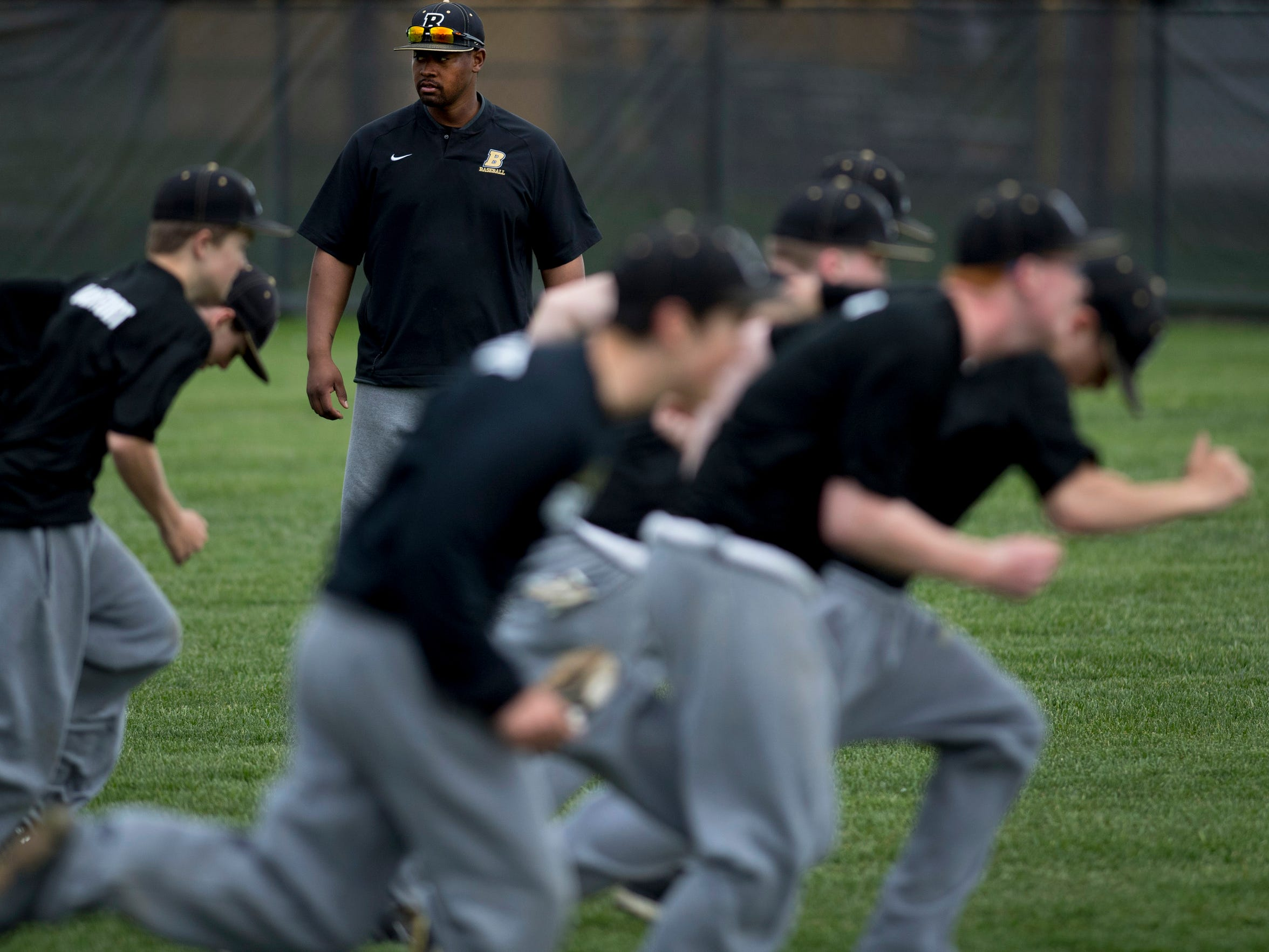 Boonville baseball coach Eric Barnes oversees his team's sprint drills during a hitting and conditioning practice Monday afternoon.