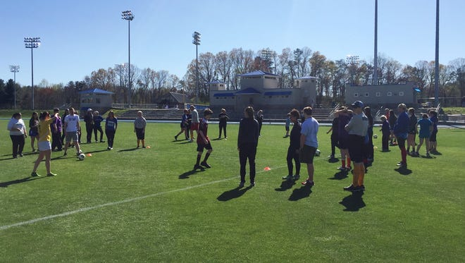 Buncombe County Special Olympics and the UNC Asheville soccer teams recently partnered for two special events.