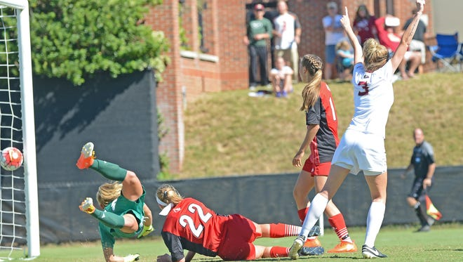 FSU midfielder Megan Connolly scores the game-winning goal against Louisville at the FSU Soccer Complex Sunday afternoon.