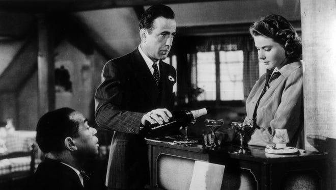 """Dooley Wilson (from left), Humphrey Bogart and Ingrid Bergman have Paris in """"Casablanca."""""""