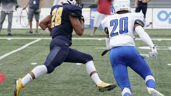 Siena Heights' Kaleb Jefferson carries the ball during a game in the 2019 season. [Telegram photo by Mike Dickie'