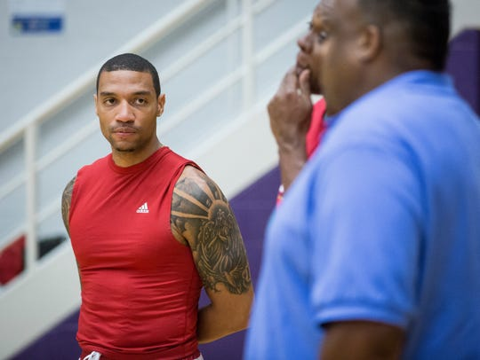 Jeremiah Davis works with Central's basketball team