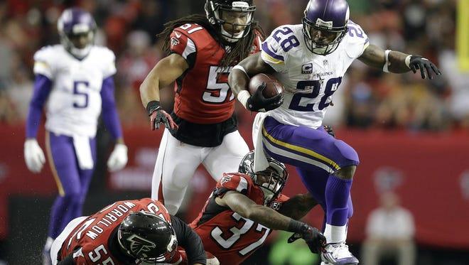 Minnesota Vikings running back Adrian Peterson (28) runs against the Atlanta Falcons during the second half of the Nov. 29 game in Atlanta.