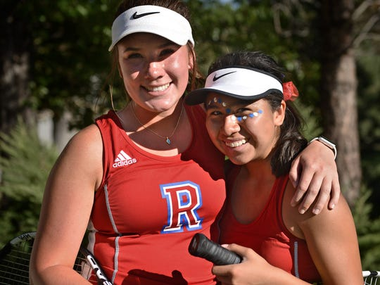 Reno high's tennis doubles partners Jill Rovetti, left, and Jazlyn Parker pose for a photo at the Caughlin Ranch Athletic Club on Oct. 6, 2017.