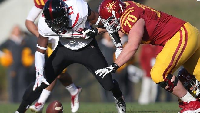 Iowa State offensive lineman Daniel Burton did not participate in team warm-ups on Saturday.
