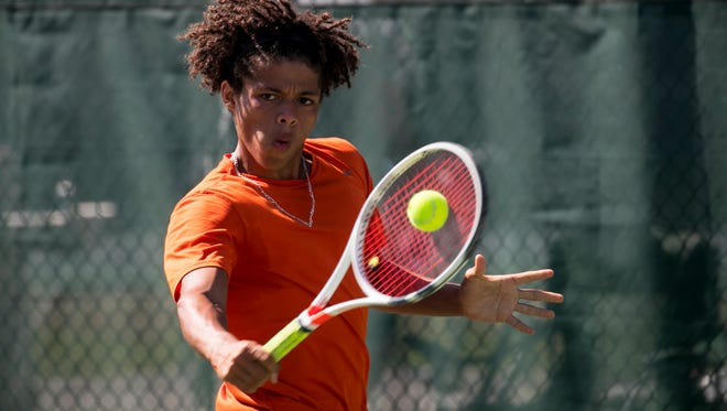 Lely's Diego Alvarez plays Cape Coral's Ian Ziegler in the finals of the District 2A-12 tennis championships on Thursday, April 19, 2018, at Three Oaks Community Park in Fort Myers.