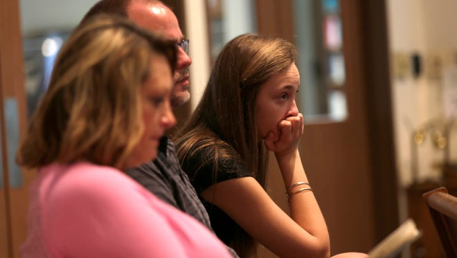 Brianna Stanke, 16, a tenth grade student at Antigo High School, listens to a service at the Antigo United Methodist Church the morning after a school shooting at the prom, April 24, 2016. Stanke left the prom approximately 30 minutes before the shooting occurred.