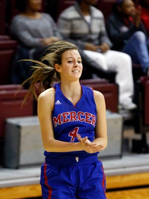 Mercer County's Seygan Robins celebrates after knocking down a three.  