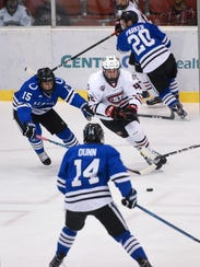 Blake Winiecki drives with the puck during the first