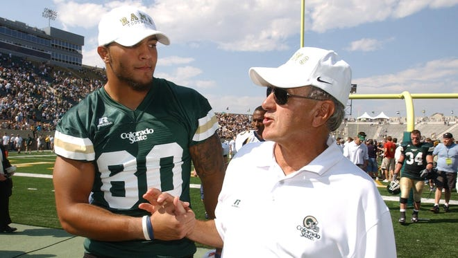 Former CSU tight end Kory Sperry and former coach Sonny Lubick walk off the field at Hughes Stadium after the game with California in September 2007. Lubick isn't eligible for the College Football Hall of Fame despite his 108 victories at CSU.