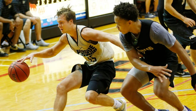 Spike Albrecht works to keep the ball away from Carsen Edwards in the Purdue men's basketball team scrimmage Saturday, August 6, 2016, at Lafayette Jeff's Crawley Center.