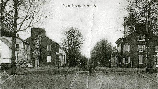 """Maravene (Codd) Covert of the York area shared several old pictures and postcards from the Dover area. This postcard shows the first house and the corner of the square where Maravene Covert's house and her great-grandparents' house were. It also shows Crone's store where the Hotel Dover was and the steeple of the Lutheran church that her family attended, she wrote. """"Our lot went all the way back to the alley. We always had a big garden and there were fruit trees there. I remember having swings in the the tree and also climbing and playing in the trees. The Fire House was directly across the alley. It faced Canal Road. The siren would scare me at night when it went off. ... It looks different now."""""""