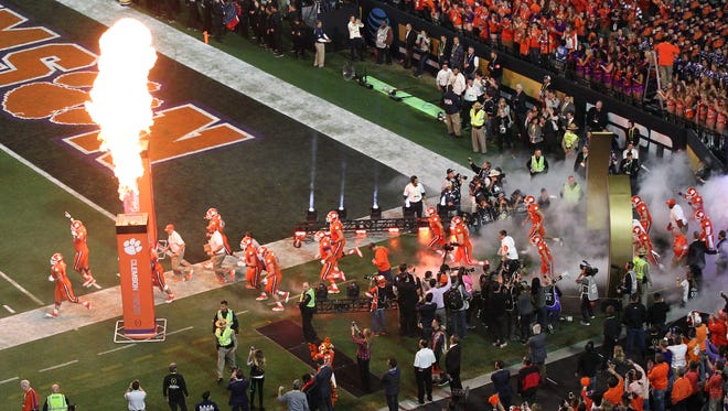 Clemson players take the field before kickoff in last year's national championship game against Alabama at University of Phoenix Stadium. Clemson's back-to-back appearances in the game is giving the university a boost, especially in athletic fundraising.