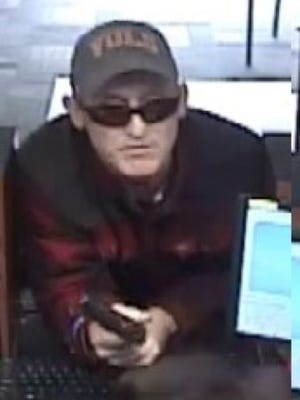 Officials say that the suspect in a robbery at the First Tennessee Bank on Merchants Drive fired one shot from a handgun before telling bank employees that he was carrying a pipe bomb.
