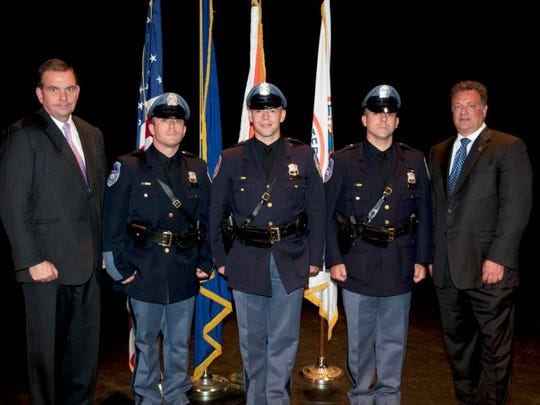 From left, Commissioner George N. Longworth, Police Officer Paul DeSousa, Police Officer Michael McAllister, Police Officer Richard Lepore and Deputy Commissioner Joseph Yasinski.