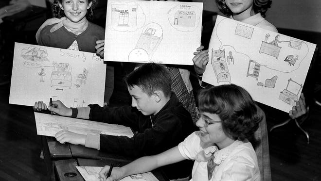 "These five students at Maury School have put their ideas on paper in the ""Draw the Dream You Save For"" project sponsored by the United States Treasury Department on 22 Apr 1951.  Showing what Defense Bonds will bring them are (Standing Left to Right) Patsy Wadlington of 472 Malvern, Joyce Shinault of 270 North Montgomery, Martha Sue Parrish of 155 North Pauline, (Seated Left to Right) Richard Gaines of 92 North Bellevue and Martha Nell Rush of 1255 Tutwiler."