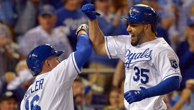 Kansas City first baseman Eric Hosmer (35) celebrates with designated hitter Billy Butler (16) after hitting a two-run home run against the Los Angeles Angels during the third inning of the 2014 ALDS on Sunday at Kauffman Stadium, in Kansas City, Mo.