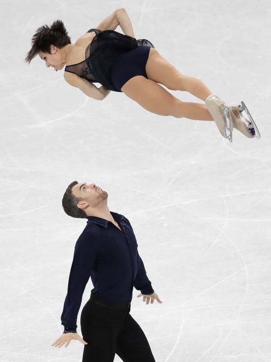 Meagan Duhamel and Eric Radford of Canada perform in the pair figure skating short program in the Gangneung Ice Arena at the 2018 Winter Olympics in Gangneung, South Korea, Wednesday, Feb. 14, 2018. (AP Photo/Julie Jacobson)