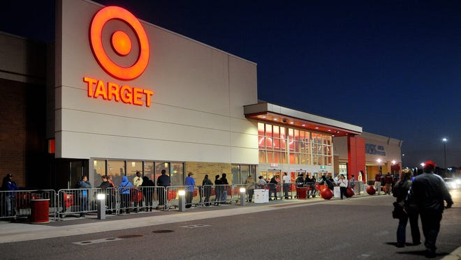 Hundreds of shoppers get a jump on Black Friday, waiting in line outside the Target store in Palm Bay on Thanksgiving night.