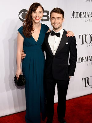 Erin Darke, left, and Daniel Radcliffe attend the 68th Annual Tony Awards at Radio City Music Hall on June 8, 2014, in New York City.