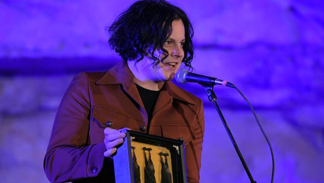 The Tennessee Department of Tourist Development presented Jack White and Third Man Records with a gift of three framed bats before a music event at Bluegrass Underground on Sept. 29, 2017. White was the host of event.