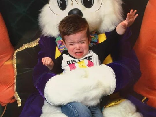 Xander Gray, 22 months, tries to escape from Valley West Mall's Easter bunny.