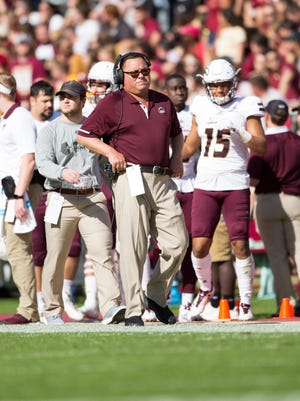 Michel (center) coached five first-team All-Sun Belt Conference defensive linemen in two stints at ULM from 1999-2008 and 2016-17.