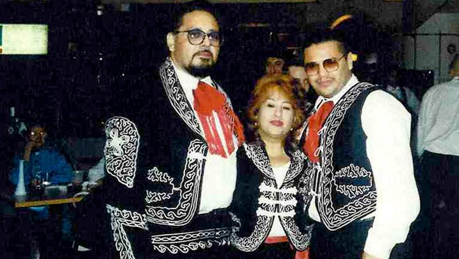 Undated photo of Jose G. Martinez, wife Lucina and son Alex.