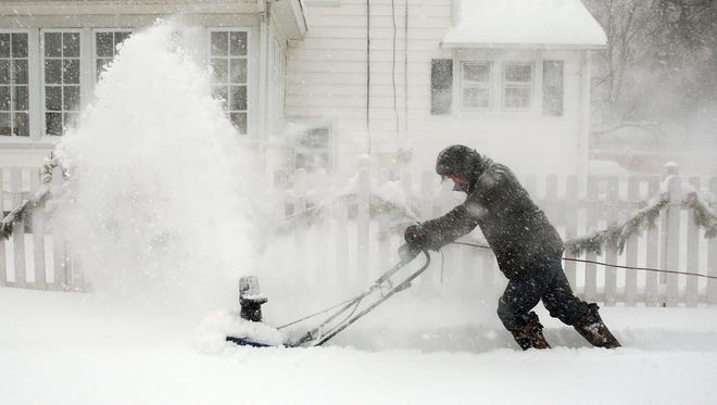 Ernie Young of Morristown snowplows his sidewalk on Mills Street as whipping winds and whiteout conditions, winter storm Jonas arrived early Saturday morning in Morris County and accumulation totals for the area have been upped, now projecting between 18 to 24 inches. January 23, 2016, Morristown, NJ.