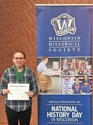 Grace Holmgren of Oconto poses with her certificate