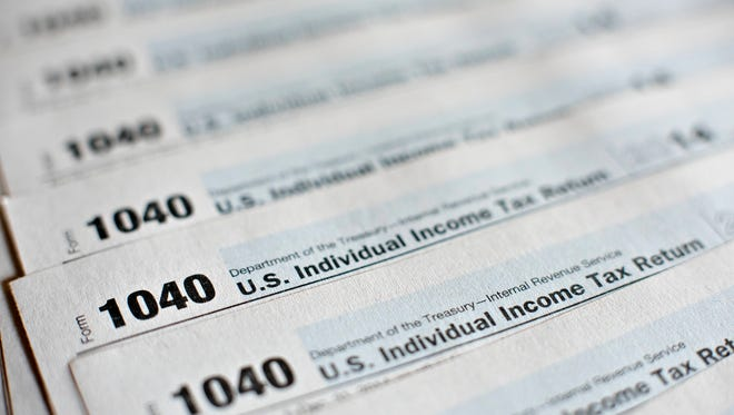 U.S. Department of the Treasury Internal Revenue Service (IRS) 1040 Individual Income Tax forms for the 2014 tax year.