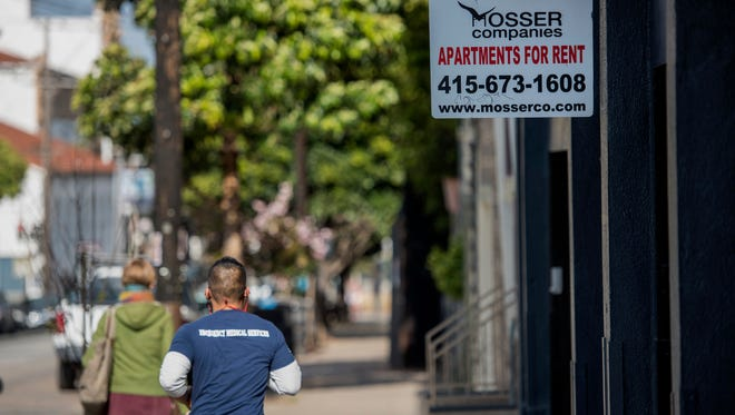 "Pedestrians walk past a ""For Rent"" sign in the Mission district of San Francisco in 2015. Data sources tell consistently different stories about the pace of rent growth in cities across the United States."