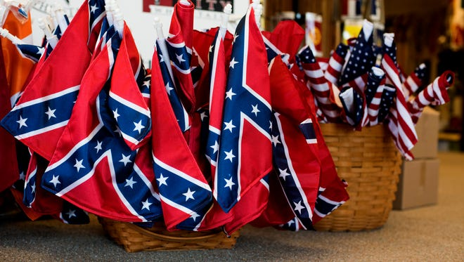 Confederate and American flags are displayed inside of the showcase room at Alabama Flag and Banner, where Confederate flags are manufactured, on April 12, 2016 in Huntsville, Alabama. The company, which sells American flags and manufactures Confederate flags, sold around 20,000 flags last year and about 12,000 of those were confederate flags.