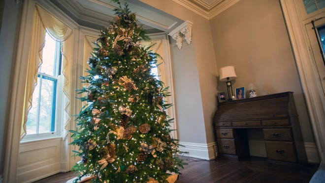 Dried hydrangeas, bows and pinecones decorate the living room christmas tree in the Samuel Allen house.