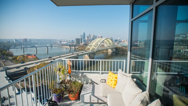 From the living room is a door to the back patio of Deborah Fox's space at SouthShore along Riverboat Row. Fox and her fiance enjoy a close view of downtown Cincinnati.