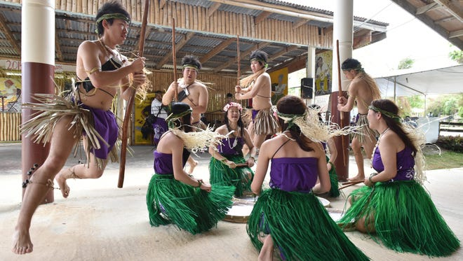 Japan-based dance group Famagu'on Tano' Yan I Tasi performs during the Dinaña Minagof Chamorro Dance Festival in 2015.