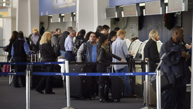 Travelers at Terminal C at Newark Liberty International Airport.