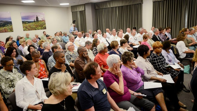 The county commission meeting was standing room only as about 50 people shared their views on Buncombe County's $419 million budget June 6.