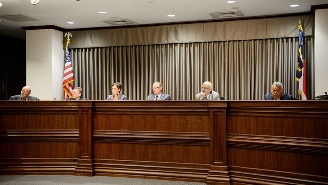 Six of the seven Buncombe County commissioners during a June 2017 meeting.
