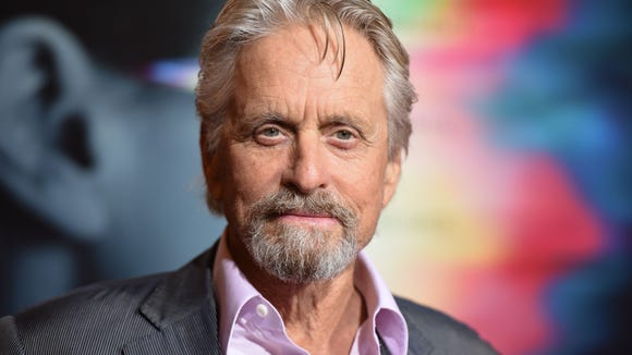 Actor Michael Douglas arrives for the premiere of 'Flatliners'
