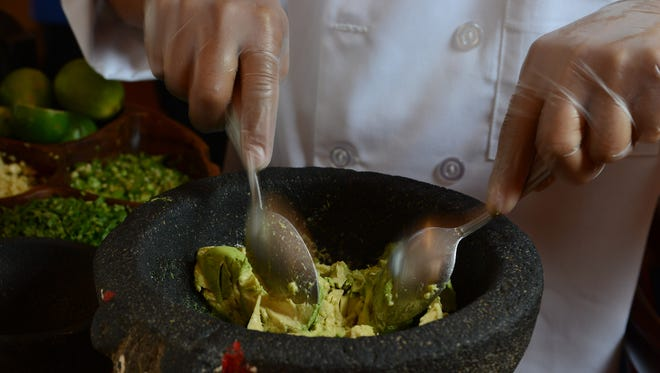 Riviera Maya. Guacamole being made. MICHAEL KARAS / STAFF PHOTOGRAPHER