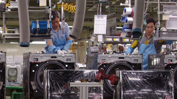 LG employees assemble washing machines at the company's Changwon production facility.