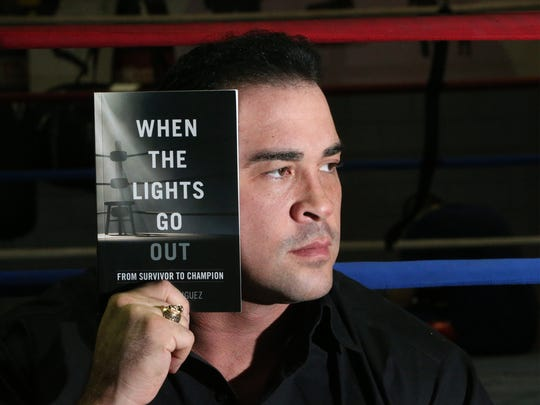 """Retired El Paso boxer David Rodriguez has written a book, """"When the Lights Go Out,"""" about his life."""