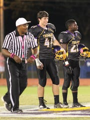 Sean Gallagher (41) was one of three ASH captains for last week's game against Pineville, joining fellow seniors Ladarian Parker (23) and Daniel Reid (36).