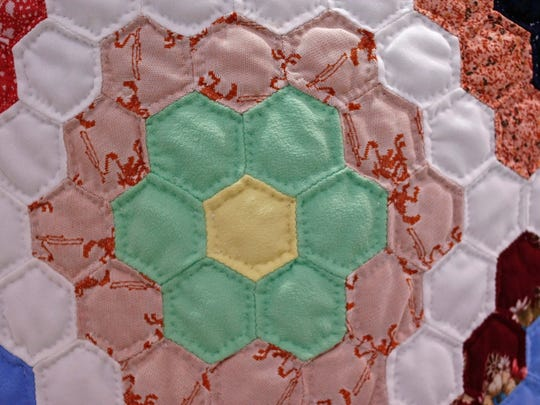 The quilt created by Edna Bowden was made from polyester clothes.
